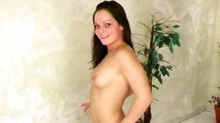 Kittenish long-haired brown-haired plays with her snatch