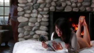Passionate lesbian sexual intercourse near the fireplace