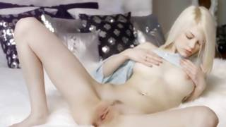 Pale cutie with fine vulva is masturbating herself hard