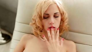 Impressive curly light-haired fingering her exciting female genetalia
